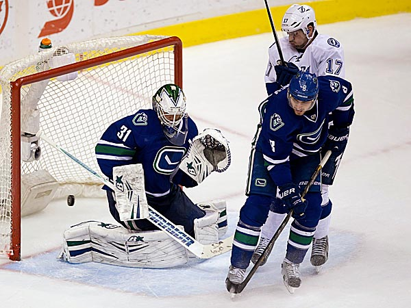 Canucks goalie Eddie Lack allows a goal to the Lightning´s Valtteri Filppula while being screened by Alex Killorn as the Canucks´ Chris Tanev defends. (Darryl Dyck/The Canadian Press/AP)