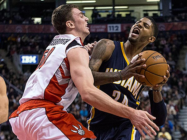 The Pacers´ Paul George drives into the Raptors´ Tyler Hansbrough. (Chris Young/The Canadian Press/AP)