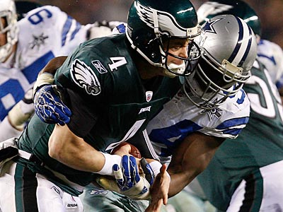 Eagles quarterback Kevin Kolb gets sacked by DeMarcus Ware of the Cowboys in the first half. (David Maialetti/Staff Photographer)
