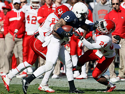 Houston´s Daniel Spencer and Kent Brooks bring down Penn State´s Chaz Powell. (AP Photo/Brandon Wade)
