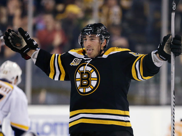 Bruins left wing Brad Marchand sticks out his tongue as he celebrates his goal during overtime against the Nashville Predators during an NHL hockey game, Thursday, Jan. 2, 2014, in Boston. The Bruins won 3-2. (Charles Krupa/AP)