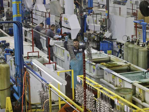FILE - In this Thursday, Oct. 10, 2013, file photo, employees at Sheffield Platers Inc. work on the factory floor in San Diego. The Institute for Supply Management issues its U.S. manufacturing index for December on Thursday, Jan. 2, 2014 (AP Photo/Lenny Ignelzi, File)