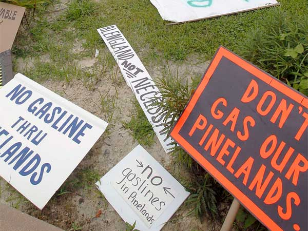 Protest signs at a hearing on the pipeline proposal. (Akira Suwa / Staff Photographer)
