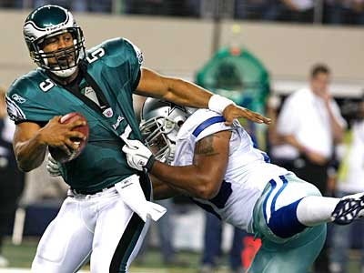 Eagles Donovan McNabb is sacked by Cowboys Anthony Spencer in the fourth quarter. ( Ron Cortes / Staff Photographer)