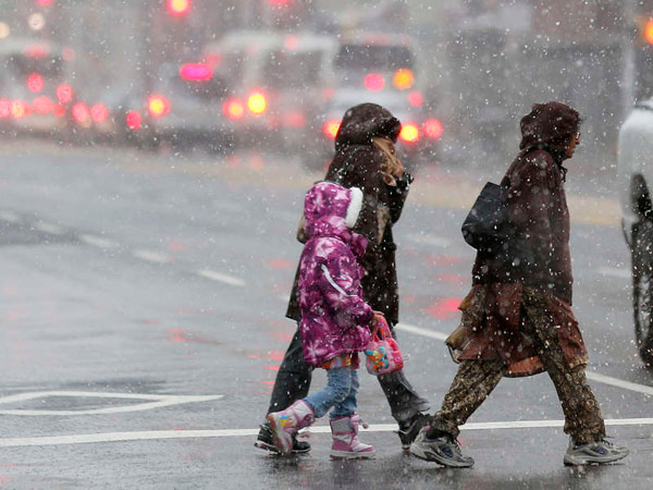 Snow falls near Four Corners, the main intersection in downtown Newark, N.J. (AP File Photo)