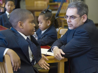 SRC Chairman Pedro Ramos with Dunbar Elementary sixth grader Samuel Smith IV.  (David M Warren / FILE)