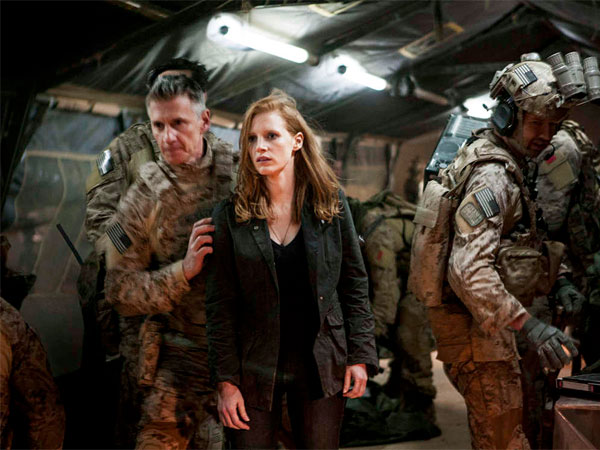 Jessica Chastain with Christopher Stanley (left), Alex Corbet Burcher as her fellow operatives. She is obsessed with getting bin Laden.