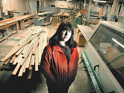 Anna Maria Vona stands on the empty shop floor of Carmana Designs. (Laurence Kesterson / Staff Photographer)