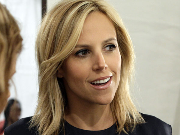 "Designer Tory Burch is interviewed backstage before her spring 2010 collection is presented during Mercedes-Benz Fashion Week, in New York. She was named a Forbes´ Billionaire three days after she settled ""all claims"" with her ex-husband over Tory Burch LLC. (AP Photo/Richard Drew)"