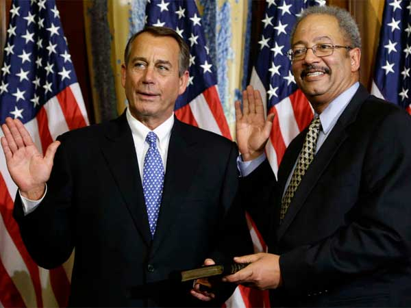 In one of many mock swearings-in Thursday on Capitol Hill, U.S. Rep. Chaka Fattah glad-hands it with House Speaker John Boehner. (Associated Press)