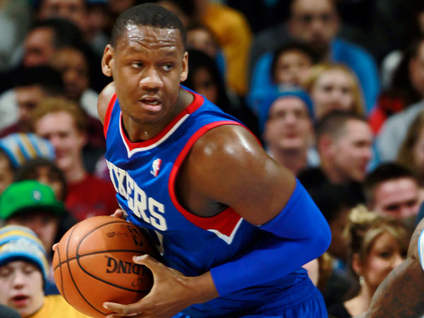Lavoy Allen, left, picks up a loose ball as Denver Nuggets guard Nate Robinson covers in the fourth quarter of the Sixers´ 114-102 victory in an NBA basketball game in Denver on Wednesday, Jan. 1, 2014. (David Zalubowski/AP)