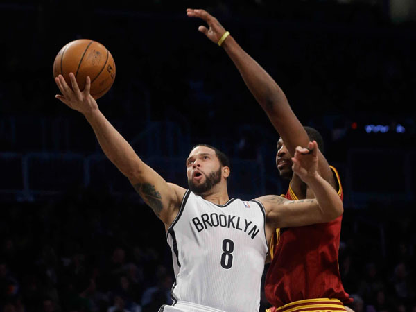 Nets´ Deron Williams (8) drives past Cleveland Cavaliers´ Tristan Thompson (13) during the first half of an NBA basketball game on Saturday, Jan. 4, 2014, in New York. (Frank Franklin II/AP)