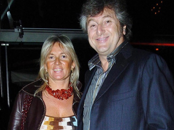 In this photo taken on March 30, 2005 Vittorio Missoni, right, and his wife Maurizia Castiglioni smile in Milan, Italy. The search resumed Saturday, Jan. 5, 2013 for a small plane that has disappeared off the Venezuelan coast with six people aboard, including Vittorio Missoni, a top executive in Italy´s Missoni fashion house, officials said. Vittorio Missoni, 58, is the director general of the iconic brand and the eldest son of the company´s founder. Flying with him on Friday´s flight from Venezuela´s Los Roques resort archipelago to Caracas, was Missoni´s wife, Maurizia Castiglioni, two Italian friends of the couple, and a crew of two Venezuelans. (AP Photo/Livio Valerio, Lapresse)