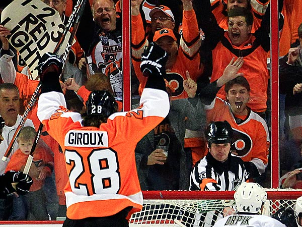Philadelphia Flyers´ Claude Giroux, left, and Jakub Voracek, right, celebrate a goal by Scott Hartnell against the Pittsburgh Penguins during the first period in Game 6 of an NHL hockey Stanley Cup first-round playoff series, Sunday, April 22, 2012, in Philadelphia. (AP Photo/Tom Mihalek)