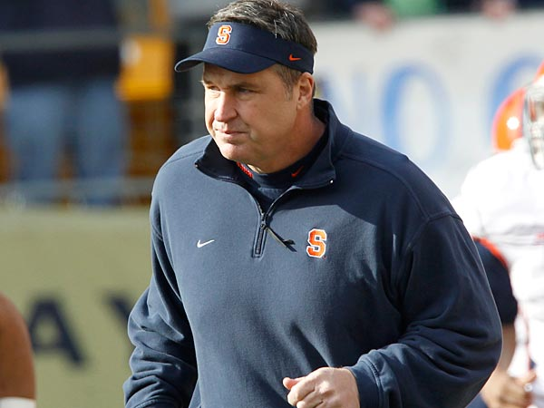 Syracuse head coach Doug Marrone leads his team on to the field for an NCAA college football game against Pittsburgh in Pittsburgh. Syracuse opens the season at home against Northwestern on Saturday. (AP Photo/Keith Srakocic, File)