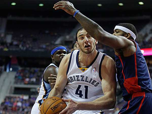 Grizzlies center Kosta Koufos drives against Pistons forward Josh Smith. (Duane Burleson/AP)