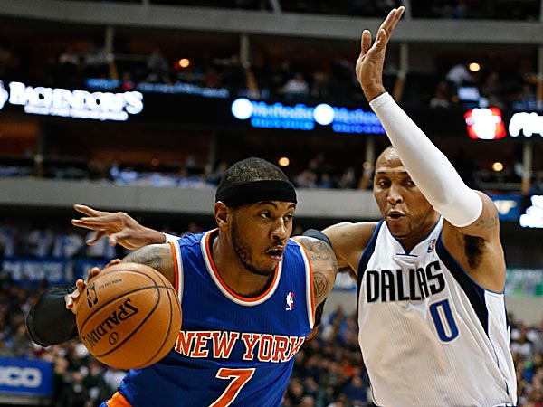 Knicks forward Carmelo Anthony drives around Mavericks forward Shawn Marion. (Sharon Ellman/AP)