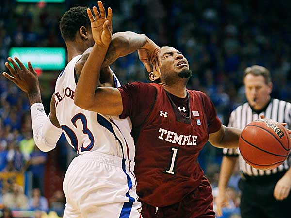 Temple guard Khalif Wyatt is covered by Kansas guard Ben McLemore during the second half. (Orlin Wagner/AP)