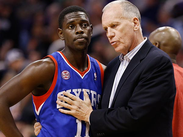 Philadelphia 76ers head coach Doug Collins, right, talks with Jrue Holiday (11) during a break in the action against the Phoenix Suns during the first half of an NBA basketball game on Wednesday, Jan. 2, 2013, in Phoenix. (AP Photo/Ross D. Franklin)