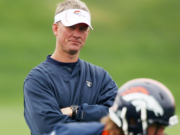 Denver Broncos offensive coordinator Mike McCoy, front, looks on during drills at the Broncos´ NFL football rookie minicamp at the team´s training headquarters in Englewood, Colo., on Saturday, May 12, 2012. (AP Photo/David Zalubowski)