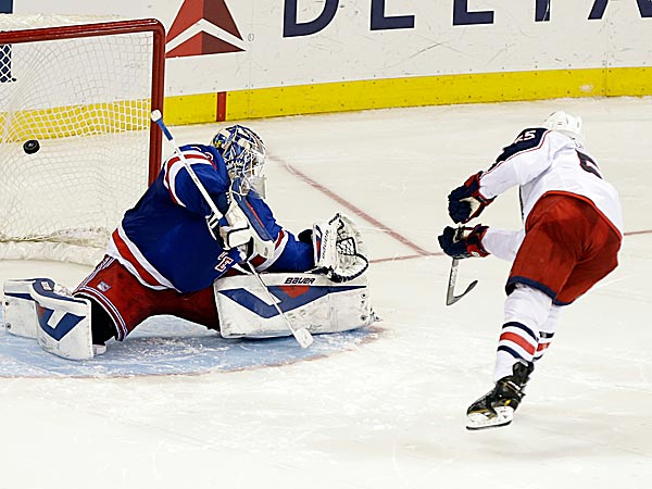 Blue Jackets center Mark Letestu scores on Rangers goalie Henrik Lundqvist. (Frank Franklin II/AP)
