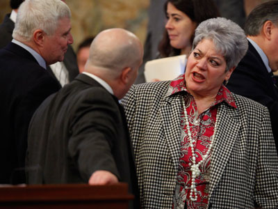 Pennsylvania Rep. Kathy Manderino, D- Philadelphia, right, talks with Pennsylvania House Majority Leader Rep. Todd Eachus, D-Luzerne, center, during debate of final passage of the table games bill on the floor of the Pennsylvania House of Representatives. (AP Photo/Carolyn Kaster)