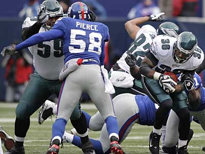 """I won't know anything about any team until February 1st or 2nd,"" said Giants linebacker Antonio Pierce (58)."