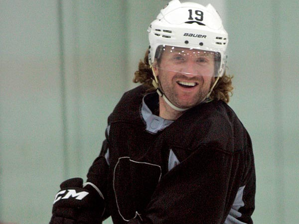 Philadelphia Flyers´ Scott Hartnell smiles after taking a shot during an informal hockey practice at the team´s training facility, Thursday, Sept. 20, 2012, in Voorhees, N.J. The league locked out its players at last weekend, its fourth shutdown since 1992. (AP Photo/Tom Mihalek)