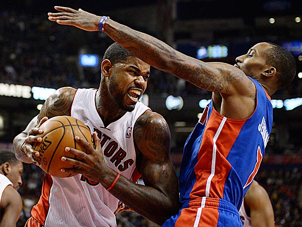 Raptors forward Amir Johnson drives to the net against Pistons guard Brandon Jennings. (Frank Gunn/The Canadian Press/AP)