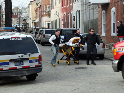 A Drug Enforcement Agency agent, who was shot and wounded in the leg, is transported to an ambulance near the near 4300 block of Fleming Street in Manayunk. (Photo by Eileen Jantz)
