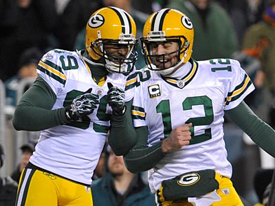 Packers quarterback Aaron Rodgers has thrown three touchdowns so far against the Eagles. (Clem Murray/Staff Photographer)
