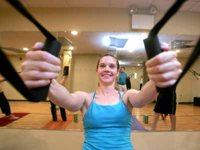 Larissa Pluta uses the aeroSling at Verge Yoga. She says it has helped her strengthen and heal an injured shoulder. (David Swanson / Staff Photographer)