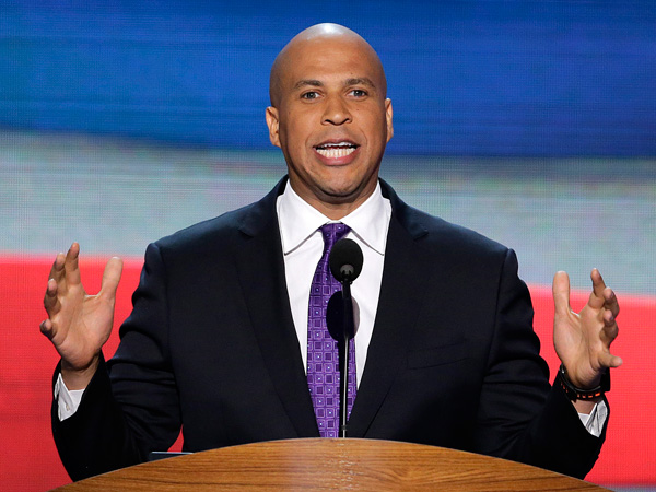 """FILE - In this Sept. 4, 2012, file photo, Newark, N.J., Mayor Cory Booker addresses the Democratic National Convention in Charlotte, N.C. In a 1992 column in The Stanford Daily, his college newspaper, Booker wrote that he was """"disgusted by gays"""" before a transformative experience with a gay peer counselor changed his views. (AP Photo/J. Scott Applewhite, File)"""