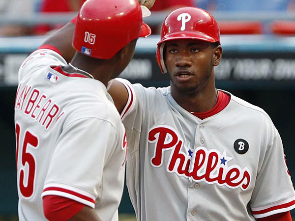 John Mayberry Jr. (left) hit .245 in 149 games in 2012, while Domonic Brown hit .235 in 56 games. (Wilfredo Lee/AP file photo)