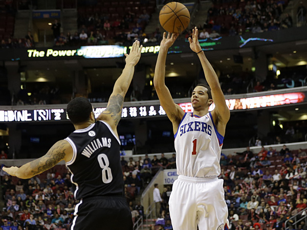 Philadelphia 76ers rookie point guard Michael Carter-Williams shoots over Deron Williams of the Nets. (Matt Slocum/AP)
