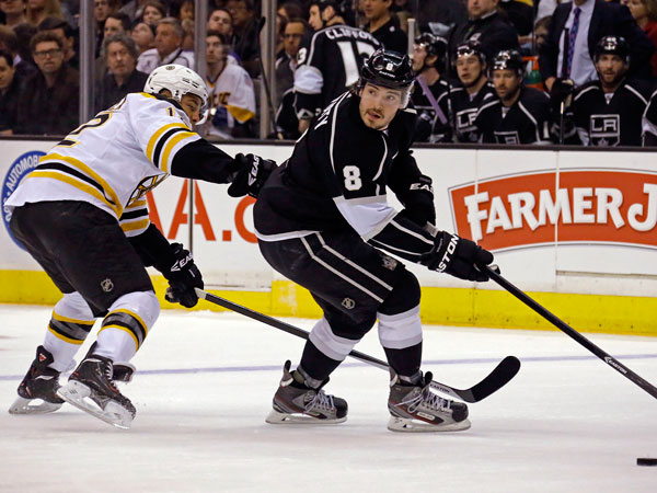 Kings defenseman Drew Doughty (8) and Boston Bruins right winger Jarome Iginia (12) skate in the first period of an NHL hockey game in Los Angeles Thursday, Jan. 9, 2014. The Kings won, 4-2. (Reed Saxon/AP)