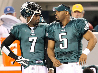 Donovan McNabb stands next to Michael Vick at Cowboys Stadium. (Yong Kim / Staff Photographer)