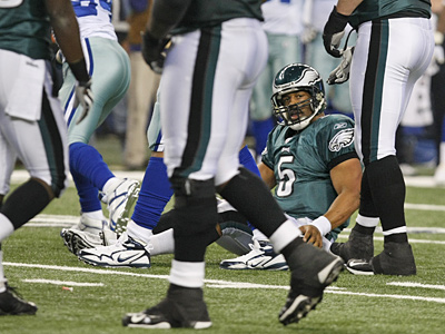 Donovan McNabb sits on the field after taking a sack against the Cowboys yesterday. (Ron Cortes / Staff Photographer)