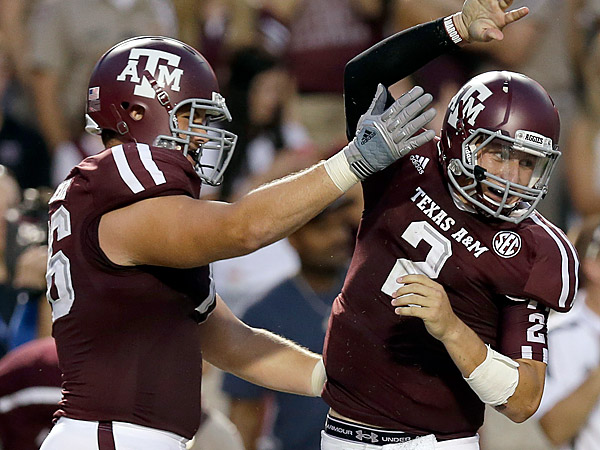 Texas A&M quarterback Johnny Manziel (2) celebrates his touchdown run with teammate Luke Joeckel, left, during the second quarter of an NCAA college football game against South Carolina State, Saturday, Sept. 22, 2012, in College Station, Texas. (AP Photo/David J. Phillip)