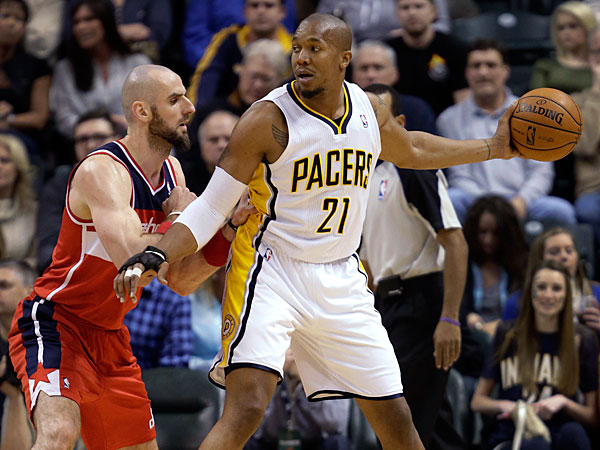 Pacers forward David West, right, looks past Washington Wizards center Marcin Gortat, of Poland, during the first half of an NBA basketball game in Indianapolis, Friday, Jan. 10, 2014. The Pacers won 93-66. (AJ Mast/AP)