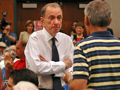Sen. Arlen Specter listens to an unidentified man as he voices his concerns during a town hall meeting Aug. 11, 2009 in Lebanon, Pa. ( Tom Gralish/ Staff Photographer )