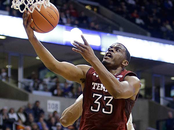 Temple guard Scootie Randall (33) drives against Xavier in the second half of an NCAA college basketball game, Thursday, Jan. 10, 2013, in Cincinnati. Randall scored 13 points in the game won by Xavier 57-52. (Al Behrman/AP)