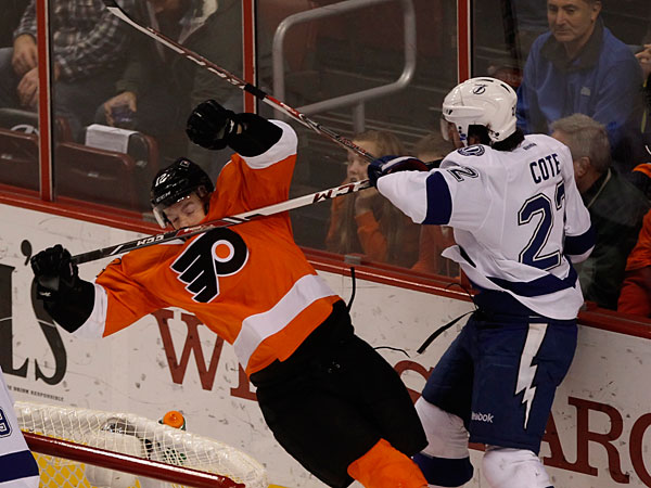 Michael Raffl gets flattened by Tampa´s Jean-Philippe Cote (Michael Bryant/Staff Photographer)