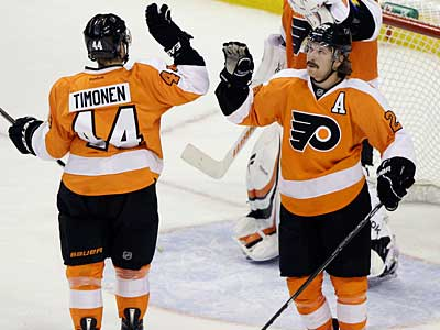 Kimmo Timonen and Claude Giroux have been named to the NHL All-Star team. (AP Photo / Matt Slocum)