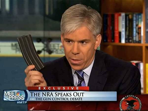"This image made from video provided by NBC´s ""Meet the Press"" shows host David Gregory holding what he described as a high-capacity ammunition magazine during the taping of the Sunday, Dec. 23, 2012 program. He was interviewing National Rifle Association executive vice president Wayne LaPierre and used the magazine as a prop while discussing gun control. Gregory won´t face charges for possession of a high-capacity magazine D.C. prosecutors announced Friday, Jan. 11, 2013 saying criminal charges wouldn´t serve the public´s best interests. (AP Photo/Meet the Press)"