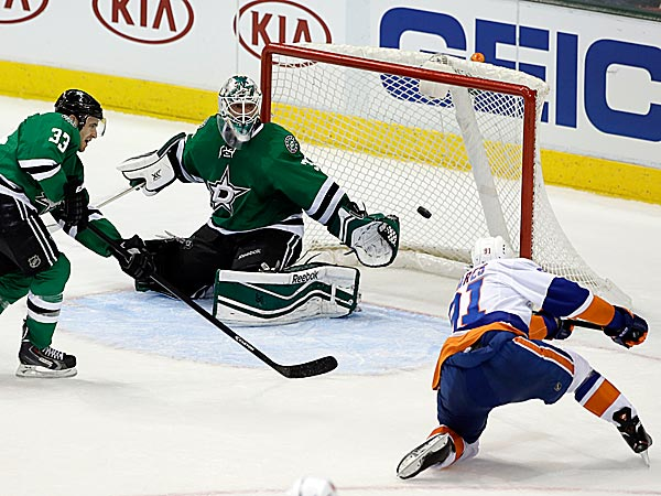 The Stars´ Alex Goligoski watches as goalie Dan Ellis is unable to stop a shot by Islanders center John Tavares. (Tony Gutierrez/AP)