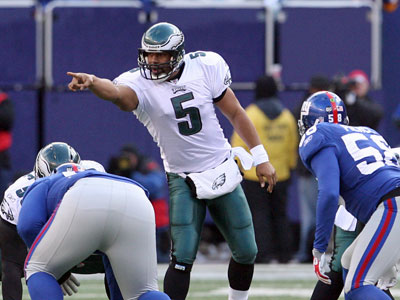 Eagles quarterback Donovan McNabb points at the line of scrimmage against the New York Giants on Sunday. His opponent this Sunday, Arizona´s Kurt Warner, predicted McNabb would be back on top after his benching seven weeks ago. (Yong Kim / Staff Photographer)