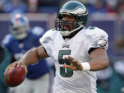 Eagles&acute; quarterback Donovan McNabb scrambles with the football in the<br />second quarter against the New York Giants on Sunday. He won that game and many others, but are his stats good enough to get him into the Hall of Fame without a Super Bowl ring on his finger? (Yong Kim / Staff Photographer)