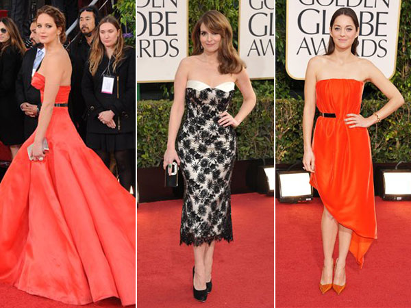 Jennifer Lawrence, Tina Fey and Marion Cotillard on the Golden Globes red carpet. (AP Photos)