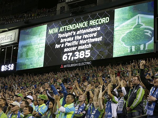 Seattle fans have turned out in huge numbers to watch the Sounders ever since they joined Major League Soccer. (Ted S. Warren/AP file photo)
